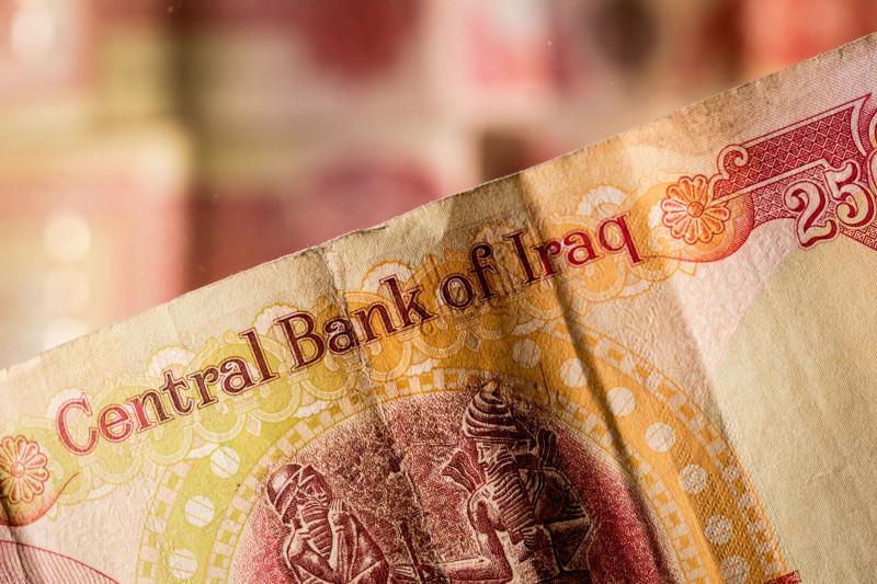 ورقة نقدية عراقية من فئة 25 ديناراً. الحكومة العراقية خفّضت قيمة العملة 23% في 19 ديسمبر 2020
