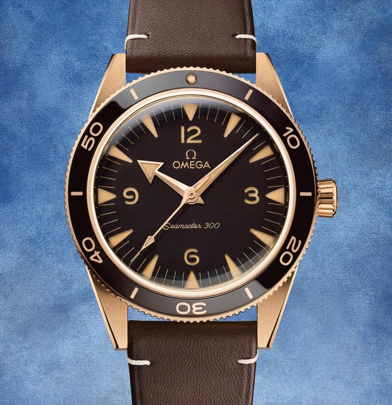 """الساعة """"أوميغا ساماستر 300 برونزية ذهبية"""""""