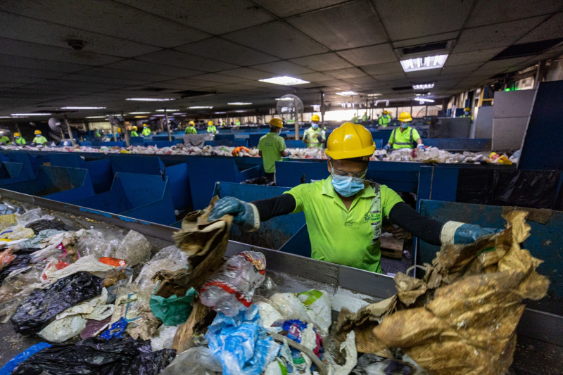 Workers sorting garbage at a facility in the Emirate of Sharjah